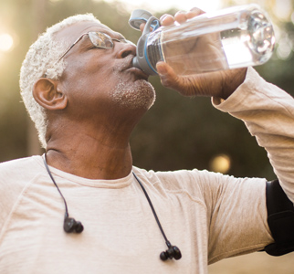 Older man drinking from a water bottle